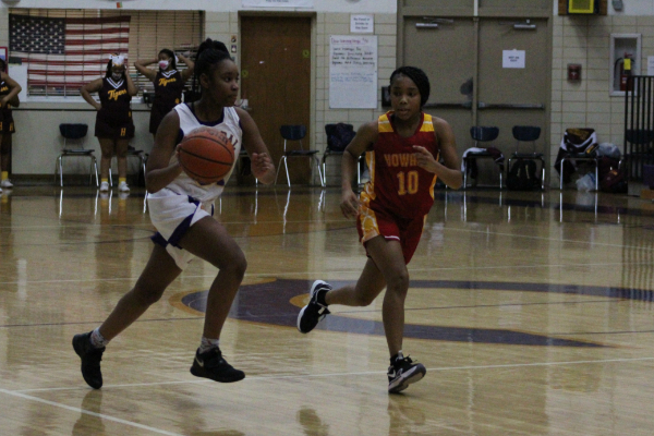 PHOTO GALLERY: CENTRAL GIRLS' BASKETBALL 2020-21 -- Junior Alissa Walton dribbles down the court.