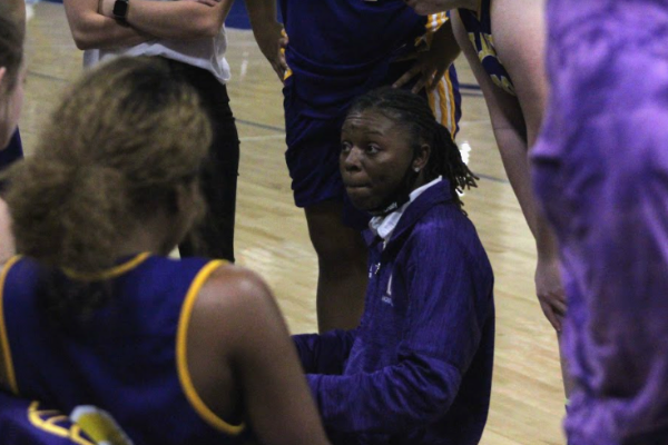 PHOTO GALLERY: CENTRAL GIRLS' BASKETBALL 2020-21 -- Coach Sandrea Sylman pulls the team together for a huddle.
