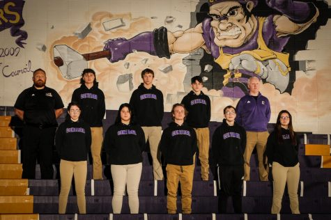 2020-21 WRESTLING WRAPS UP -- The wrestling team stands together in the gym. Top (left to right): Coach Ryan Mallory, Ethan Black, Brecken Griffith, Noah Pinion, Coach James Massengale. Bottom (left to right): Dahlia Frankel, Gabby Gray, Roby Thomas, Jaiden Hutton, Isabelle Moody.