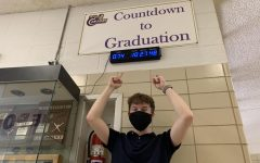 THE FINAL STRETCH -- Senior Grayson Catlett points to the graduation countdown clock.