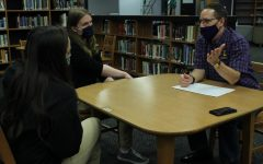 DR. JIMMY MCCOLLUM VISITS DIGEST -- Dr. Jimmy McCollum speaks to Senior Blake Catlett, editor-in-chief, and Junior Karleigh Schwarzl, sports editor, in Central's library.
