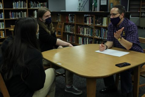 DR. JIMMY MCCOLLUM VISITS DIGEST -- Dr. Jimmy McCollum speaks to Senior Blake Catlett, editor-in-chief, and Junior Karleigh Schwarzl, sports editor, in Central