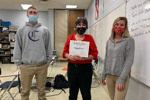 PEGGY MOYER IS CENTRAL'S TEACHER OF THE MONTH FOR MARCH -- Peggy Moyer is presented with her teacher of the month certificate by Luke Keown and Amber Burchfield.