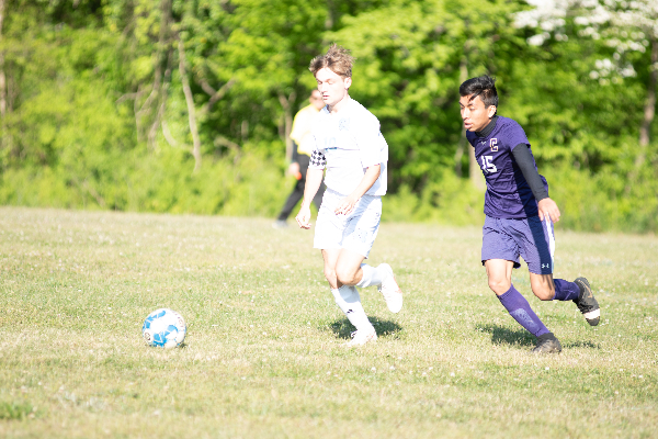 THE 2021 BOYS SOCCER SEASON COMES TO A CLOSE -- Junior, Luis Fransisco dribbles past his opponent.