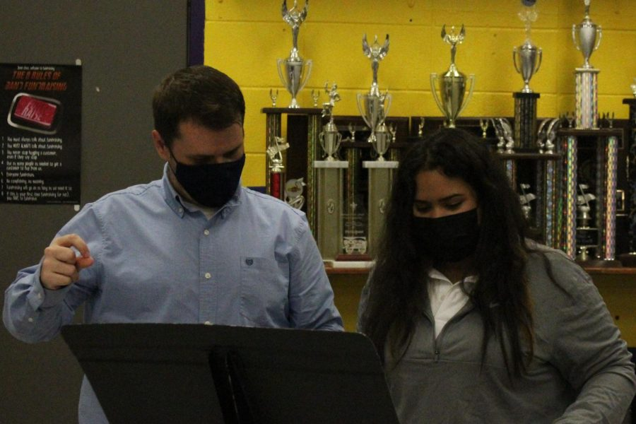 CENTRAL WELCOMES JOSHUA SINGLETON AS NEW BAND DIRECTOR -- Singleton is assisting student in 4th period band class.