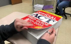 (file phto)-- A student prepares to practice with the 2021-2022 ACT Prep Book.