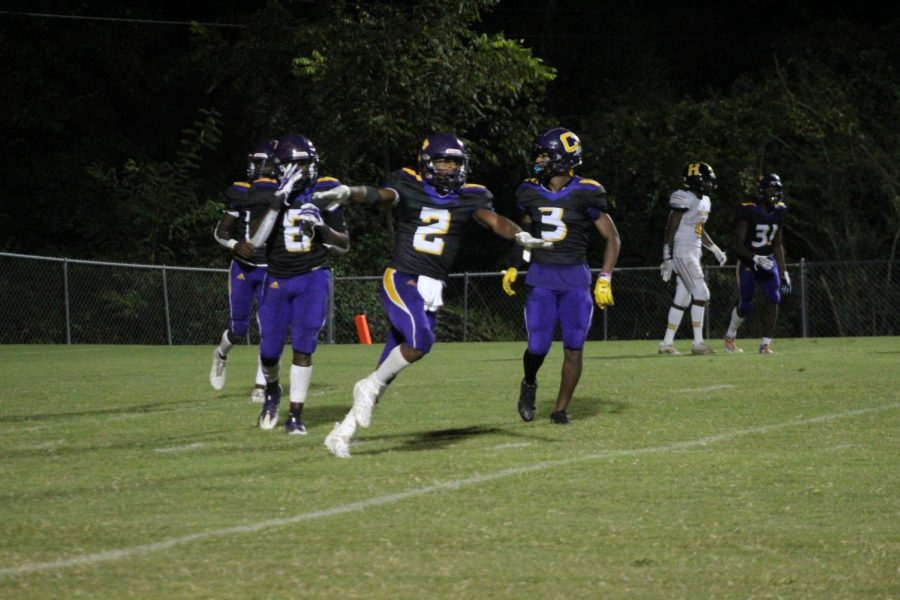 EXTRA INNINGS: DEFENSE PLAYS KEY ROLE IN POUNDERS THREE GAME WIN STREAK -- The Central defense celebrating after making a goal line stand vs. HIxson.