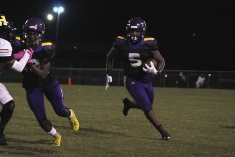 CENTRAL FOOTBALL STUNS THE LIONS WITH WITH BIG REGION 3-4A WIN -- Senior, Michael Watson runs the ball down field to gain a first down against the Wildcats.