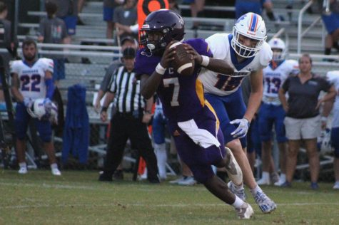 CENTRAL FOOTBALL WINS THEIR FIRST HOMECOMING GAME IN SEVEN YEARS -- Quarterback, Ronye Watson rolls out of the pocket and looks up for a pass.