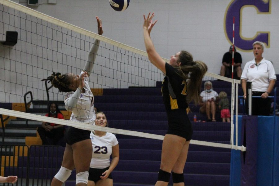 CENTRAL VOLLEYBALL TAKES A TOUGH LOSS AGAINST CSTHEA, EAST HAMILTON, AND HIXSON -- Addason Wellington spiking the ball down, earning a point for the lady pounders.