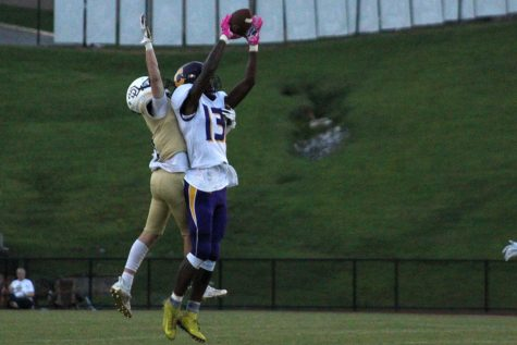 FOOTBALL: POUNDERS RUN OVER SODDY DAISY IN 18-7 DISTRICT VICTORY -- Junior, Donovan Smith goes up for a catch.