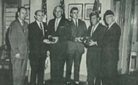 LOOKING BACK: 1962-1963 STUDENT COUNCIL OBTAINED THE FIRST SET OF AMERICAN FLAGS IN CLASSROOMS -- Russel Duggar and Principal H. Milsaps receive Bibles and American flags.