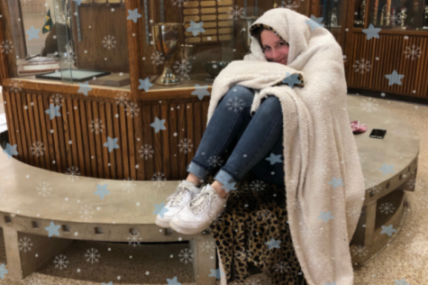 CAMRS CORNER: FALLING INTO WINTER -- Student shivers in the unbearable cold in the front of the school.