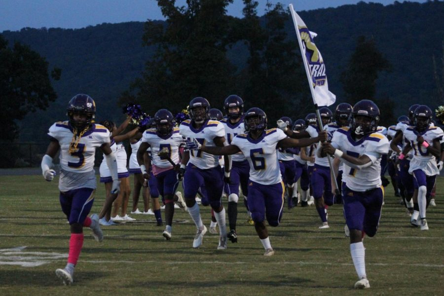 EXTRA INNING: POUNDERS FOOTBALL EYEING HOME PLAYOFF GAME -- The football team running out on the field vs. East Hamilton.